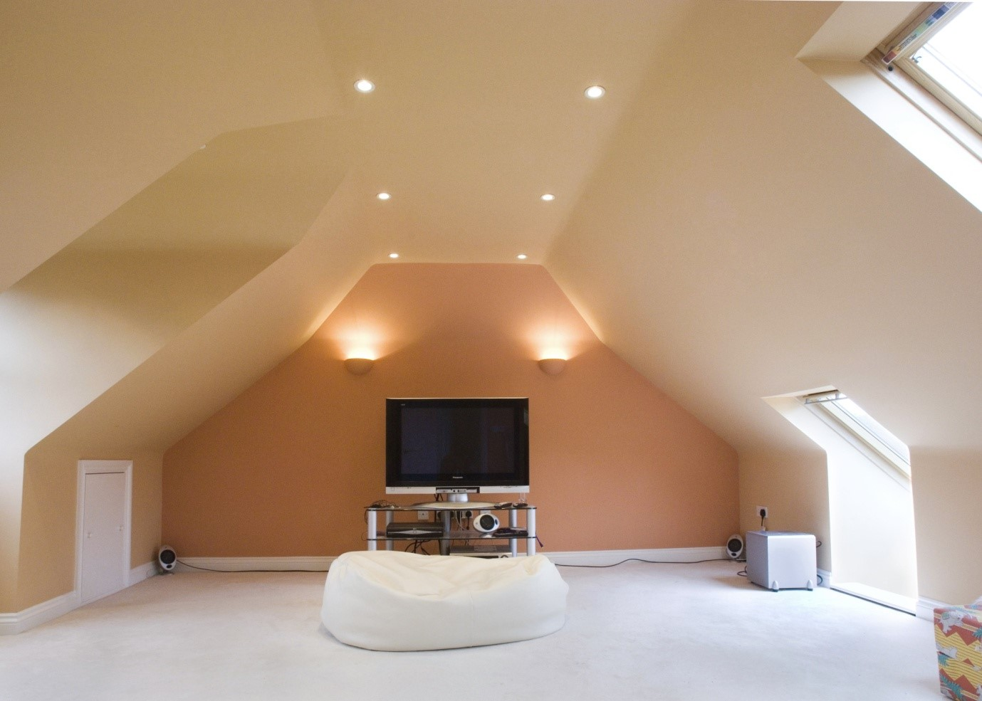 The loft conversion provided a further bedroom (thereby giving 5) and a teenager drop down 'den'/music and entertainments room